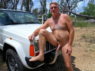 Wooly mature masculine posing naked on the nature