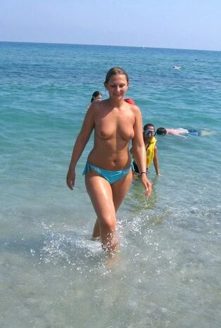 Big-boobed mature gals nudists in the sea