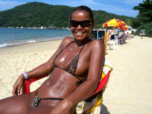 Afro lady on a beach. she's a wonderful and highly scorching